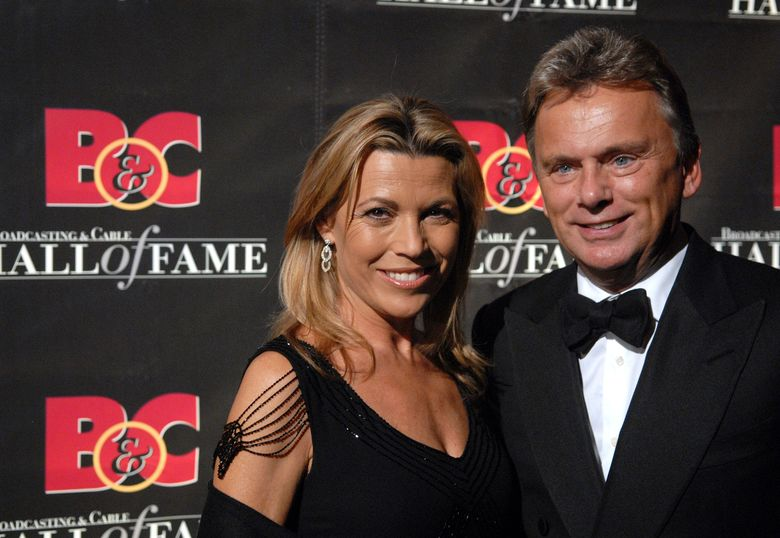 """FILE – In this Monday, Oct. 22, 2007 file photo, Game Show Host's Vanna White and Pat Sajak arrive at the 17th annual Broacasting and Cable Hall of Fame awards dinner at Cipriani's 42nd street,  in New York. Hillsdale College in Michigan says the """"Wheel of Fortune"""" host will lead the governing board at the small liberal arts school. He has served on the board for more than a dozen years. Sajak tells the campus newspaper that he's been preparing for months to succeed William Brodbeck by spending more time on campus with students and staff. College President Larry Arnn says Sajak has """"calm and steady judgment"""" and a """"wicked wit.""""( AP Photo/Peter Kramer, File)"""
