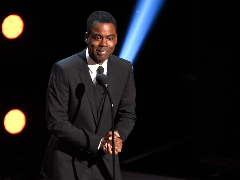 """FILE – In this March 30, 2019 file photo, Chris Rock presents the award for outstanding comedy series at the 50th annual NAACP Image Awards at the Dolby Theatre in Los Angeles. Netflix is launching its first audio venture that will feature the video streaming service's comedy programming on SiriusXM. The companies on Wednesday, April 10 announced """"Netflix Is A Joke Radio"""" will feature highlights from such comedians as Rock, Dave Chappelle, Ricky Gervais, Sarah Silverman, Jerry Seinfeld and Wanda Sykes. The channel also will feature segments from future stand-up specials and clips from Netflix's comedy talk shows.  (Photo by Chris Pizzello/Invision/AP, File)"""