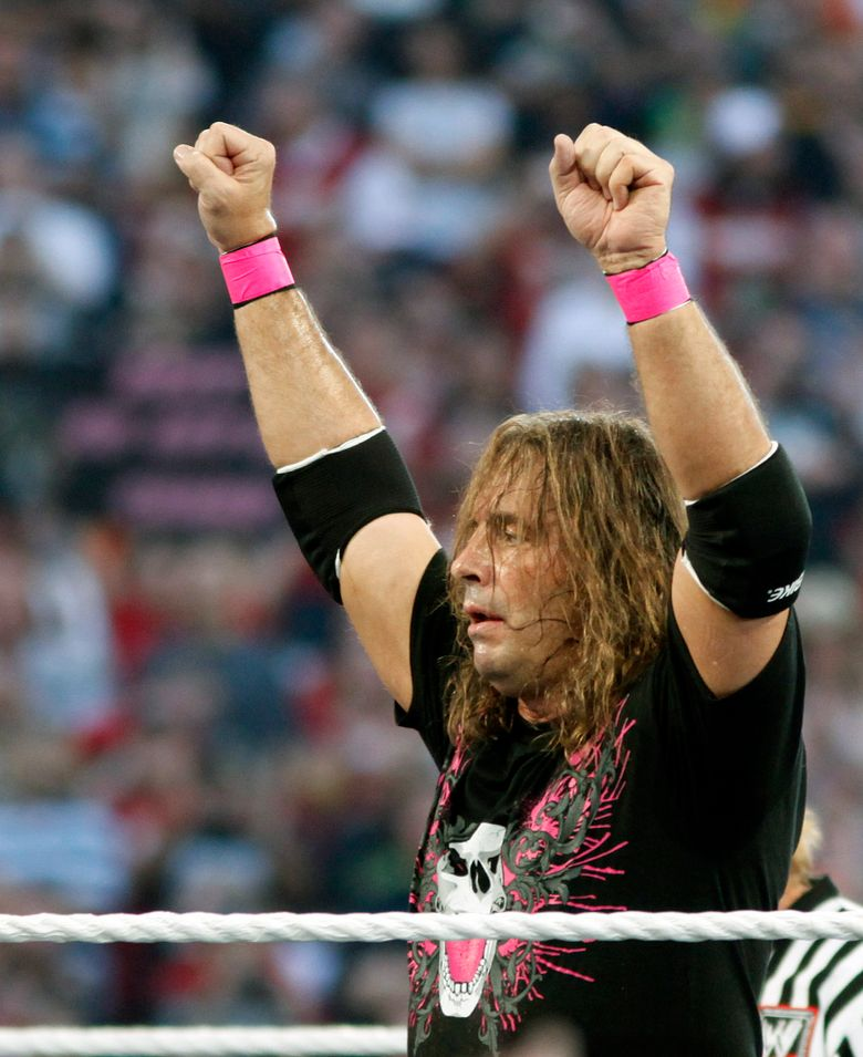 """FILE – In this March 28, 2010, file photo, Bret """"Hit Man"""" Hart celebrates his victory over Mr. McMahon at WrestleMania XXVI in Glendale, Ariz. Hart was tackled by a spectator Saturday, April 6, 2019, while he was giving a speech during the WWE Hall of Fame ceremony at Barclays Center. The attacker was promptly subdued by several people, including other wrestlers, who came to Hart's defense. Hart is okay. (AP Photo/Rick Scuteri, File)"""