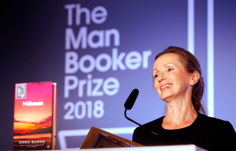 """FILE – In this Oct. 16, 2018 file photo, author Anna Burns smiles after being presented with the Man Booker Prize for Fiction 2018 for """"Milkman,"""" during the prize's 50th year at the Guildhall in London. Nigerian debut novelist Oyinkan Braithwaite and U.K. Booker Prize winner Anna Burns are among six finalists for the international Women's Prize for Fiction. (AP Photo/Frank Augstein, File)"""