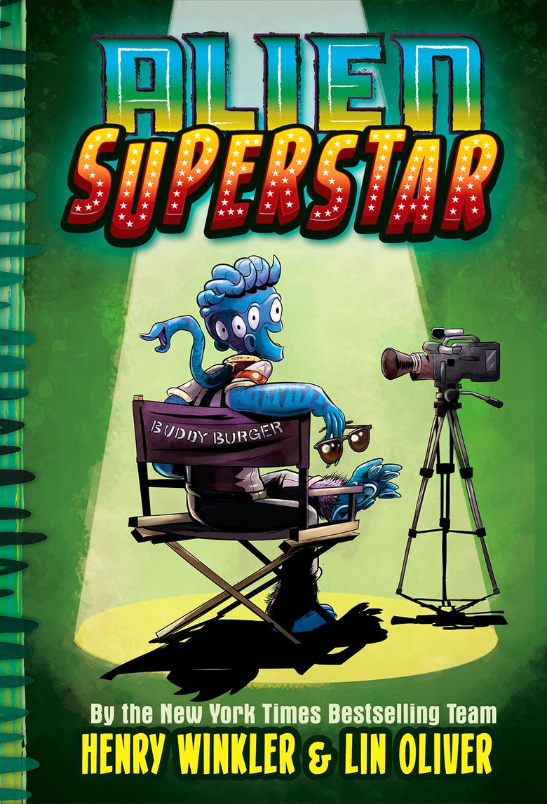 """This cover image released by Abrams shows """"Alien Superstar,"""" by Henry Winkler and Lin Oliver. Winkler is planning an out-of-this-world take on fame and show business. The 73-year-old actor known for """"Happy Days"""" and """"Barry"""" has a three-book deal with Abrams Children's Books for a middle-grade series about an alien who somehow lands in Hollywood and becomes a teen sensation. The series is called """"Alien Superstar"""" and will be co-written with Lin Oliver and illustrated by Ethan Nicolle. The first book is scheduled for Oct. 1, Abrams announced Monday, April 22, 2019. (Abrams via AP)"""