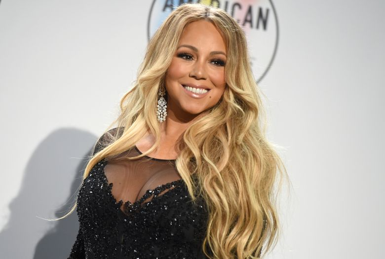FILE – In this Oct. 9, 2018, file photo Mariah Carey poses in the press room at the American Music Awards at the Microsoft Theater in Los Angeles. No artist has more No. 1 hits on the Billboard Hot 100 chart than Mariah Carey, and she will receive the Icon Award at the 2019 Billboard Music Awards. NBC and Dick Clark Productions announced Thursday, April 11, 2019, that the Grammy-winning superstar will also perform at the May 1 event in Las Vegas. (Photo by Jordan Strauss/Invision/AP, File)