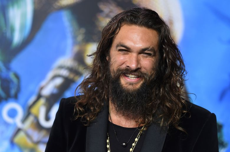 """FILE – In this Dec. 12, 2018 file photo, Jason Momoa arrives at the premiere of """"Aquaman"""" at TCL Chinese Theatre in Los Angeles. Momoa on Wednesday, April 17, 2019  released a video in which he shaved off his signature beard and mustache in order to promote recycling. He started by saying farewell to his """"Game of Thrones"""" and DC characters Drogo and Arthur Curry. Momoa said he thought he last shaved in 2012. (Photo by Jordan Strauss/Invision/AP, File)"""