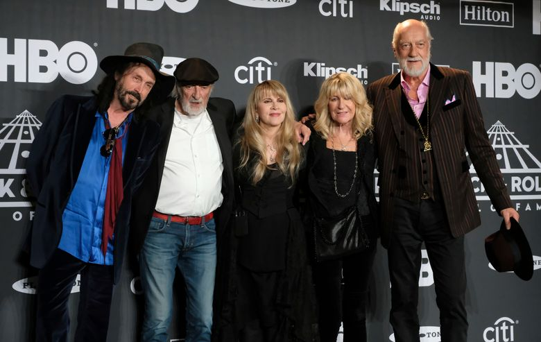 FILE – This March 29, 2019 file photo shows Inductee Stevie Nicks, center, posing with other members of Fleetwood Mac, from left, Mike Campbell, John McVie, Christine McVie and Mick Fleetwood at the Rock & Roll Hall of Fame induction ceremony in New York. Illness is forcing Fleetwood Mac to cancel a number of appearances including their upcoming Jazz Fest performance where they were a last-minute replacement for the Rolling Stones. The New Orleans Jazz & Heritage Festival says on Twitter that Fleetwood Mac is postponing four upcoming North American tour dates and their May 2 Jazz Fest performance due to Stevie Nicks' illness. (Photo by Charles Sykes/Invision/AP, File)