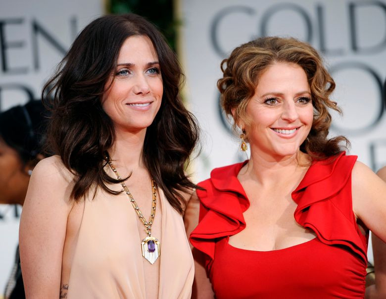 """FILE – This Jan. 15, 2012 file photo shows Kristen Wiig, left, and Annie Mumolo at the 69th Annual Golden Globe Awards in Los Angeles. """"Bridesmaids"""" writers Wiig and Mumolo are reuniting, eight years after their smash hit comedy. Lionsgate announced Wednesday, April 17, 2019, that it will produce """"Barb and Star Go to Vista Del Mar"""" from a script by the pair. They will each also co-star in the film as best friends who leave their Midwestern town for a vacation in Florida. (AP Photo/Chris Pizzello, File)"""