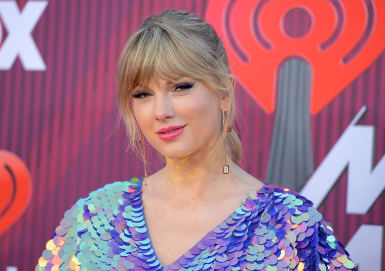 FILE – In this March 14, 2019, file photo, Taylor Swift arrives at the iHeartRadio Music Awards at the Microsoft Theater in Los Angeles. Swift says the efforts of a Tennessee LGBTQ advocacy group to fight against a handful of contentious bills moving inside the state's GOP-controlled General Assembly inspired her to make a sizeable donation. (Photo by Jordan Strauss/Invision/AP, File)