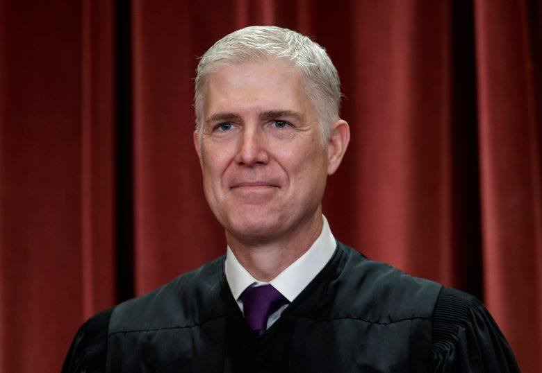 """FILE – In this Nov. 30, 2018 file photo, Associate Justice Neil Gorsuch, appointed by President Donald Trump, sits with fellow Supreme Court justices for a group portrait at the Supreme Court Building in Washington. Supreme Court Justice Gorsuch has a collection of speeches, writings and original essays coming out this fall. Crown Forum, a conservative imprint at Penguin Random House, announced Wednesday, April 3, 2019, that Gorsuch's """"A Republic, If You Can Keep It"""" is scheduled for Sept. 10. (AP Photo/J. Scott Applewhite, File)"""