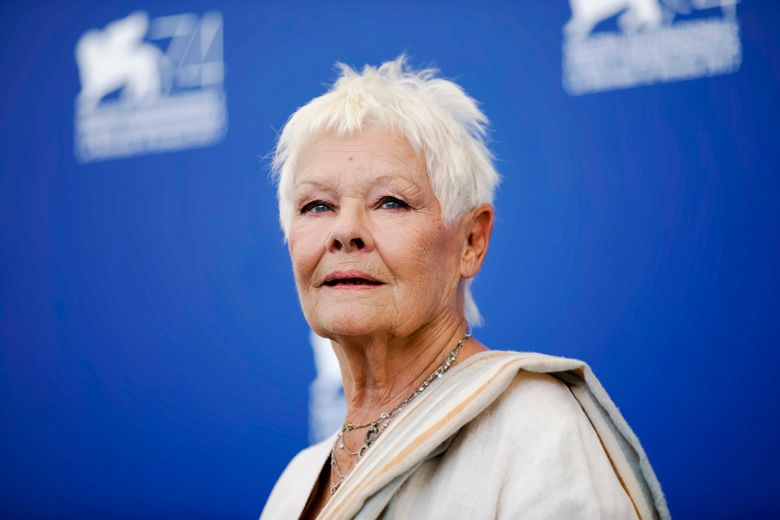 """FILE – In this Sunday, Sept. 3, 2017 file photo, actress Judi Dench poses during a photo call for the film """"Victoria And Abdul"""" at the 74th Venice Film Festival in Venice, Italy. Judi Dench is back in the world of espionage _ but her latest role is a far cry from James Bond's unflappable spy chief, M. In """"Red Joan,"""" released in Britain and the U.S. on Friday, April 19, 2019, Dench plays an elderly British woman whose quiet suburban life is upended when police come knocking, accusing her of passing nuclear secrets to the Soviet Union during the Cold War. (AP Photo/Domenico Stinellis, file)"""