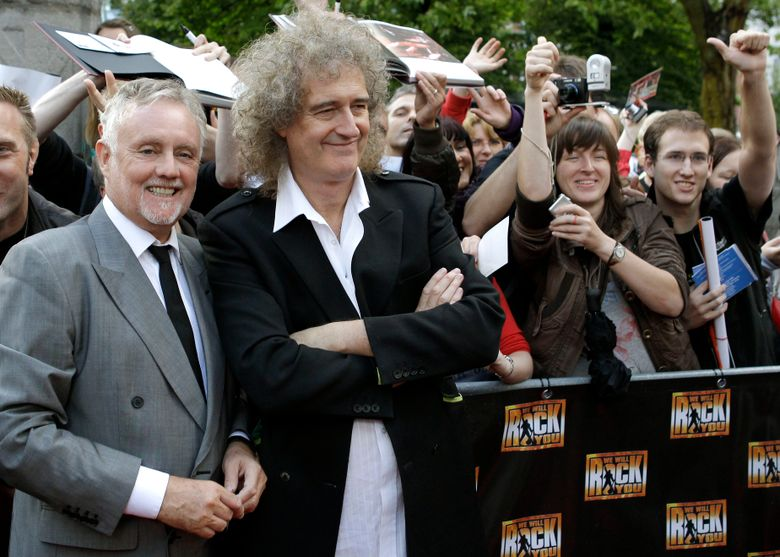 """FILE – In this Sept. 13, 2010 file photo,  members of the rock band Queen, Roger Taylor, front left, and Brian May, front right, pose during a meeting with fans to promote the musical """"We Will Rock You""""  in Berlin, Germany. The musical inspired by the music of Queen is preparing for a North America tour following the popularity of the Academy Award-winning movie, """"Bohemian Rhapsody."""" Producers on Monday, April 1, 2019, announced """"We Will Rock You"""" will open in Winnipeg, Canada, on Sept. 3. Other cities include New York, Los Angeles, Denver and Las Vegas. (AP Photo/Michael Sohn, File)"""