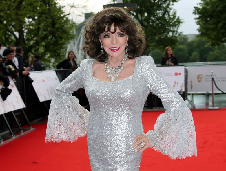 """FILE – In this Sunday, May 14, 2017 file photo, Joan Collins poses for photographers upon arrival to the British Academy Television Awards at the Royal Festival Hall in London. Joan Collins has thanked firefighters for their quick response after a blaze erupted in her London apartment. The 85-year-old actress on Monday, April 15, 2019 shared video images of a charred wall on social media after the weekend fire. She also tweeted thanks to the """"marvelous"""" firefighters who tackled the """"terrifying"""" blaze.  (Photo by Joel Ryan/Invision/AP, file)"""