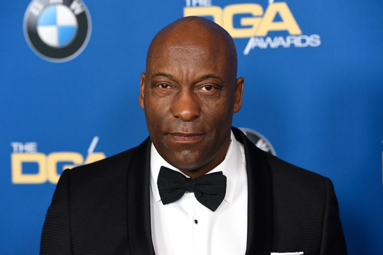"""FILE – In this Feb. 3, 2018 file photo, John Singleton arrives at the 70th annual Directors Guild of America Awards in Beverly Hills, Calif. The """"Boyz N the Hood"""" director suffered a stroke last week and remains hospitalized, according to a statement from his family on Saturday, April 20, 2019. (Photo by Chris Pizzello/Invision/AP)"""
