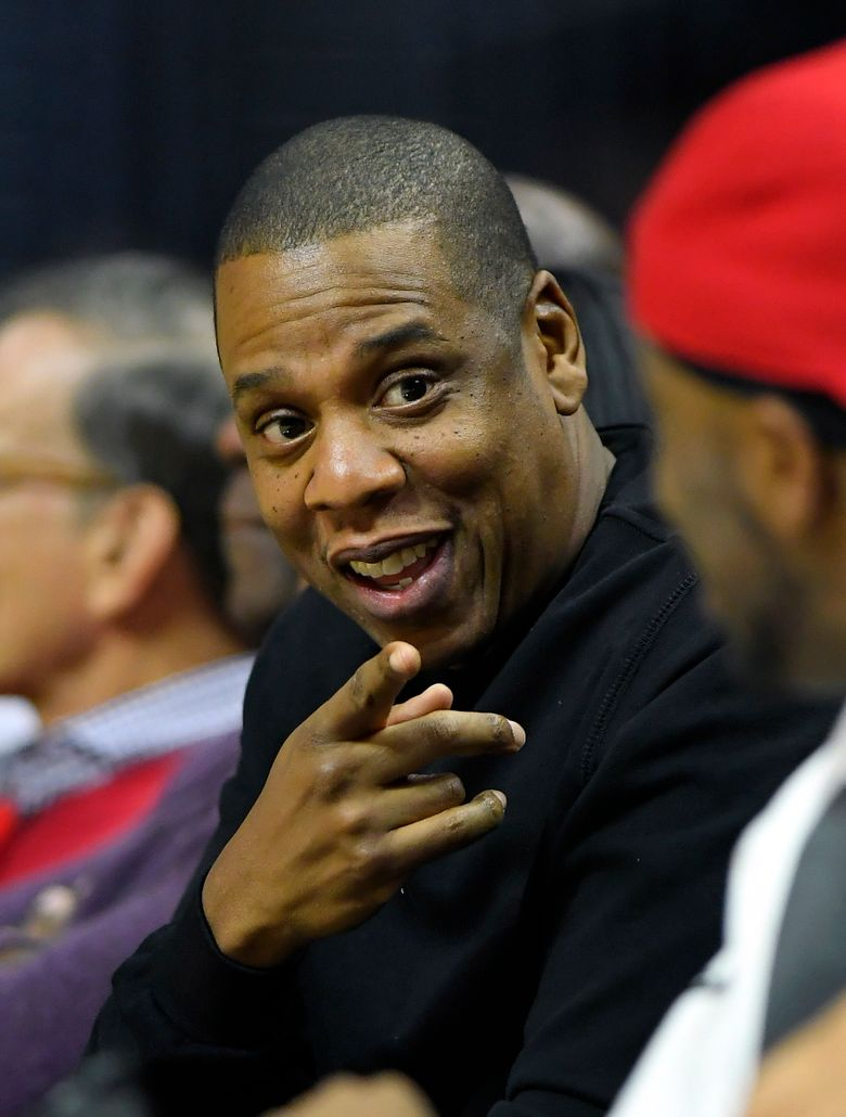 FILE – In this Dec. 7, 2016 file photo, rapper Jay-Z appears at a NBA basketball game between the Los Angeles Clippers and the Golden State Warriors in Los Angeles. Jay-Z will help re-open the newly renovated Webster Hall concert venue in New York City with a performance next week.  Tickets for the April 26 show go on sale Friday, April 19, 2019. (AP Photo/Mark J. Terrill, File)