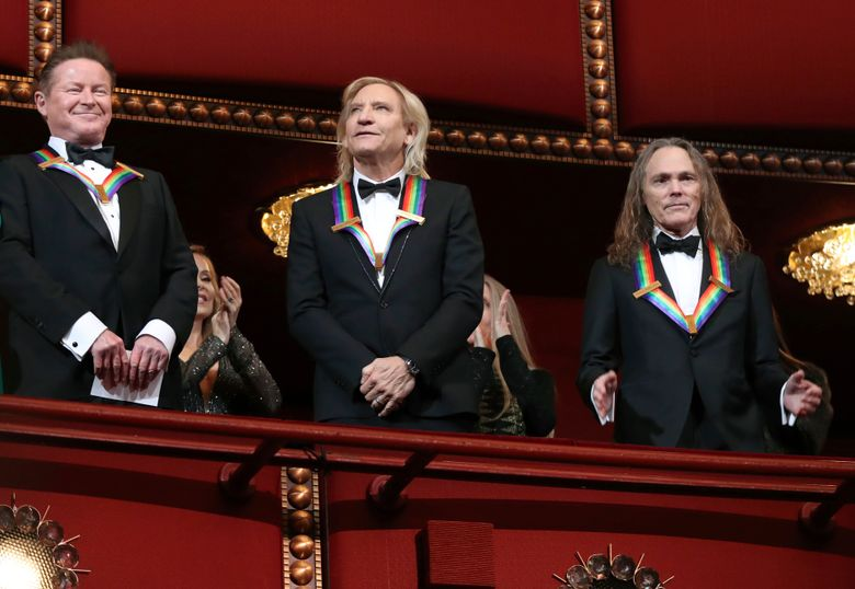 """FILE – In this Dec. 4, 2016 file photo, members of the Eagles band, from left, Don Henley, Joe Walsh, and Timothy Schmit, recipients of the 2016 Kennedy Center Honor award, applaud during the Kennedy Center Honors Gala at the Kennedy Center in Washington. The Eagles will perform their 1976 """"Hotel California"""" album in its entirety in concert for the first time. Live Nation says it will take place on Sept. 27 and 28, 2019, at MGM Grand Garden Arena in Las Vegas. Henley, Walsh and Schmit will be joined by Deacon Frey and Vince Gill for what will be the group's only North American performances of 2019. Founding member Glenn Frey, Deacon's father, died in 2016. (AP Photo/Manuel Balce Ceneta, File)"""