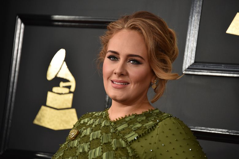 """FILE – In this Feb. 12, 2017, file photo, Adele arrives at the 59th annual Grammy Awards at the Staples Center in Los Angeles. Adele and her husband Simon Konecki have separated. The pop singer's representatives Benny Tarantini and Carl Fysh confirmed the news Friday, April 19, 2019 in a statement to The Associated Press. The statement read: """"Adele and her partner have separated. They are committed to raising their son together lovingly. As always they ask for privacy. There will be no further comment.""""  (Photo by Jordan Strauss/Invision/AP, File)"""