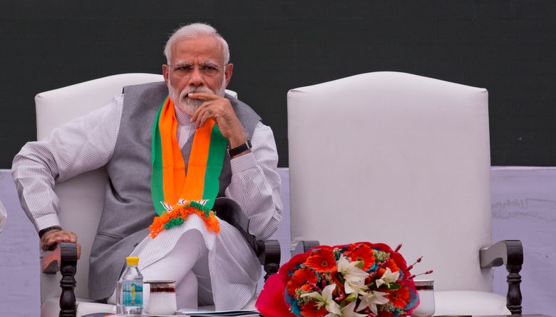 In this Monday, April 8, 2019, photo, India's Prime Minister Narendra Modi releases Bharatiya Janata Party or BJP's manifesto for the upcoming general elections in New Delhi, India. Modi came to power in 2014 promising big-ticket economic reforms. But with unemployment rising and signature policies getting panned, Modi's Bharatiya Janata Party has adopted a nationalist pitch ahead of a general election that begins this week.(AP Photo/Manish Swarup)