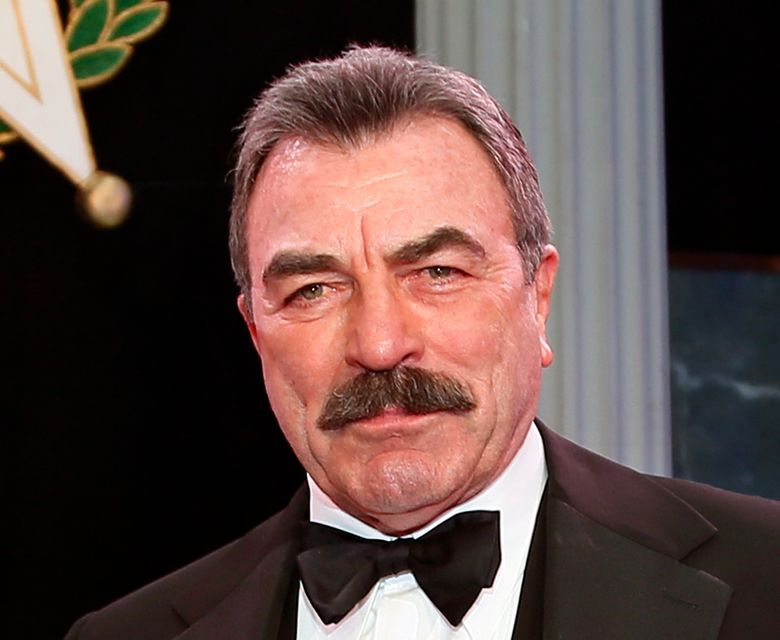 """FILE – In this Nov. 16, 2017, file photo, Tom Selleck  is shown during Oklahoma Hall of Fame induction ceremonies in Oklahoma City. Selleck is working on a memoir, and it won't just be about acting. The """"Magnum P.I."""" star has a deal with Dey Street Books, an imprint of HarperCollins Publishers. The book, announced Monday, April 8, 2019, is currently untitled and does not yet have a release date. Selleck, 74, said in a statement that he would share stories about his career, but also about life """"away from the camera.""""  (AP Photo/Sue Ogrocki, File)"""