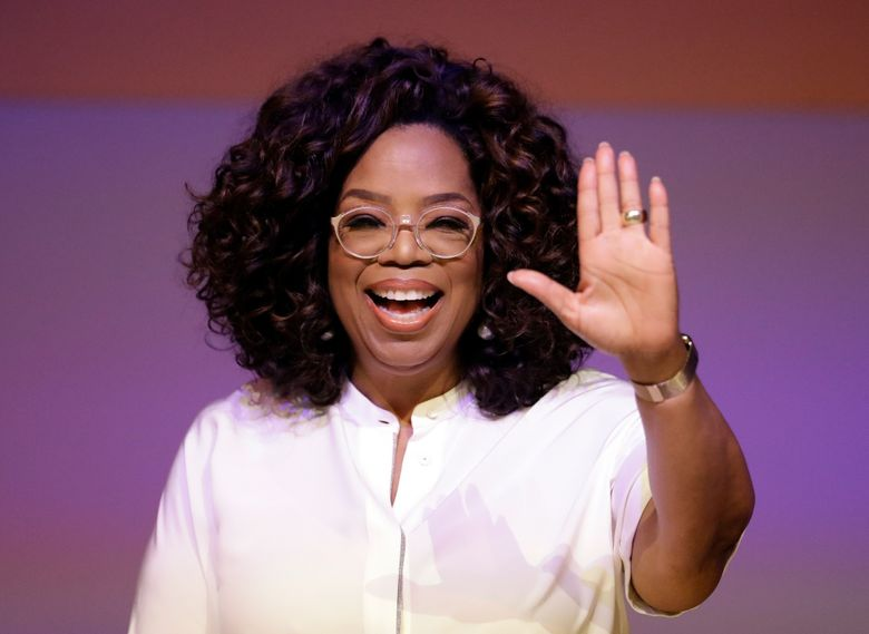 FILE- In the Nov. 29, 2018 file photo, Oprah Winfrey waves the audience during a tribute to Nelson Mandela and promoting gender equality event at University of Johannesburg in Soweto, South Africa. On Wednesday, April, 10, 2019, Winfrey gave the keynote speech at 10th annual Women in the World Summit at New York City's Lincoln Center. (AP Photo/Themba Hadebe, File)