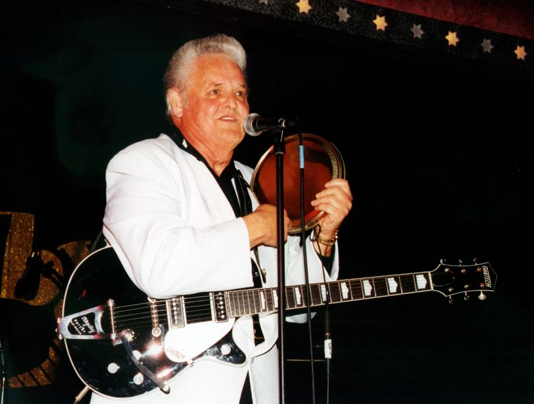 """This 2002 photo released by Redbush Classics Records shows rockabilly Hall of Famer Billy Adams performing in Hemsby, England. Adams, who wrote and recorded a rockabilly staple """"Rock, Pretty Mama,"""" died Saturday, March 30, 2019, in Westmoreland, Tenn. He was 79. (Redbush Classics Records via AP)"""