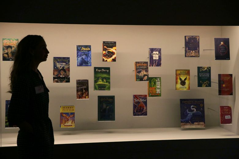 """FILE – In this Wednesday Oct. 18, 2017 file photo, a member of British Library staff poses for a picture with Harry Potter books published in several languages at the """"Harry Potter – A History of Magic"""" exhibition at the British Library, in London. Priests at a Catholic parish in northern Poland have burned books, including the """"Harry Potter"""" series, and other items that their owners said had evil forces. Images from the burning at Gdansk's Mother of Church parish on Sunday March 31, 2019, were posted on Facebook by a Catholic foundation that uses unconventional ways of religious work. (AP Photo/Tim Ireland, File)"""