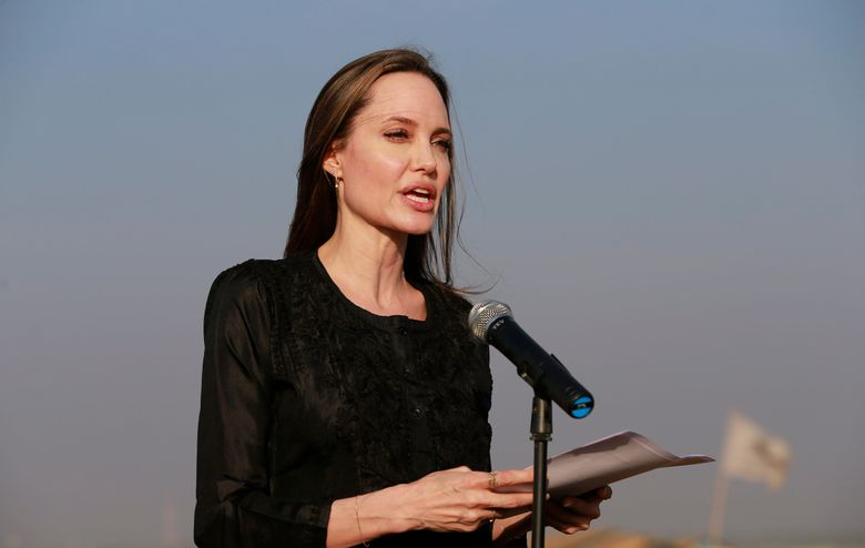 """FILE – In this Feb. 5, 2019 file photo, Angelina Jolie holds a news conference at Kutupalong refugee camp in Cox's Bazar, Bangladesh.  Jolie is not ruling out running for public office.  The 43-year-old actress and U.N. special envoy tells People magazine """"never say never!"""" However, Jolie says she's """"looking to others for leadership.""""  In her role with the U.N.'s High Commission for Refugees, Jolie recently urged nations to deploy more women peacekeepers in order to prevent sexual violence against refugees. Jolie says """"we have to change laws that treat women as second-class citizens.""""  (AP Photo, File)"""