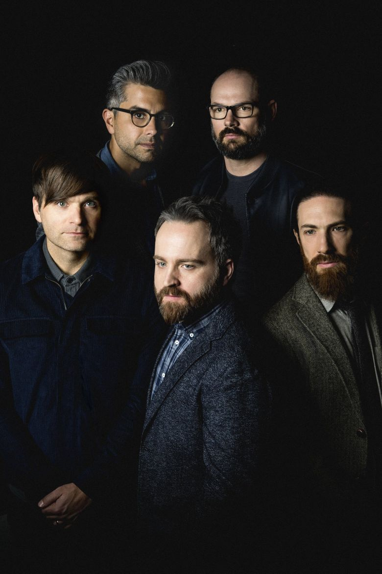 Death Cab for Cutie (counterclockwise from left: Ben Gibbard, Nick Harmer, Zac Rae, Jason McGerr and Dave Depper) went from recording in a makeshift attic studio in a Bellingham house to one of their generation's defining indie-rock bands.  (Eliot Lee Hazel)