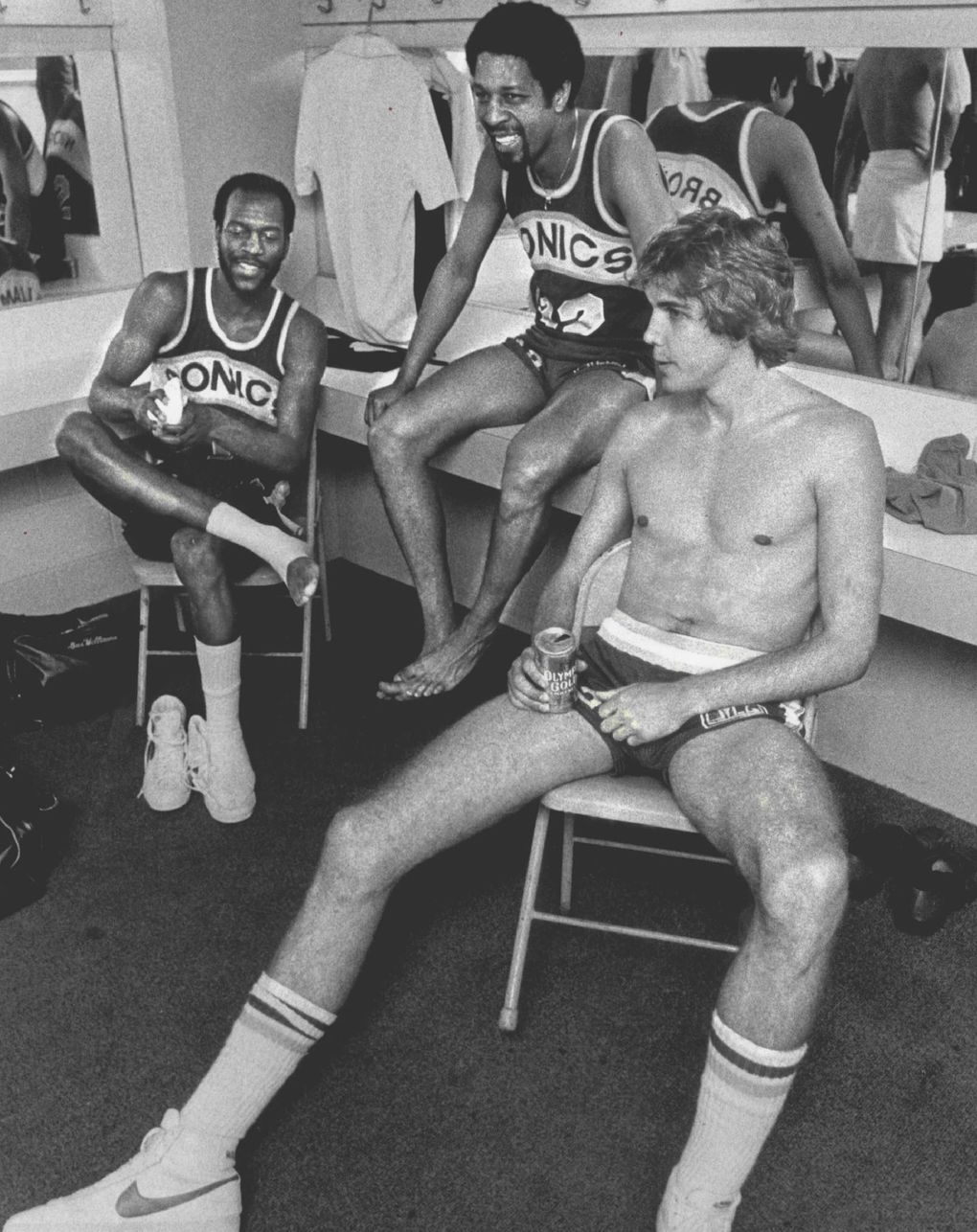 The Seattle locker room was a sea of smiles after the Sonics shaded the Phoenix Suns to keep their title hopes alive. From left: Gus Williams, Fred Brown and Wally Walker. (Matt McVay / The Seattle Times)