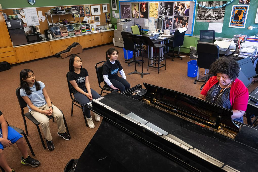 From left, Aaliyah Tab, Zi Chen and Cynthia Brunk take beginning vocals from gospel singer Cora Jackson at JazzED. (Dean Rutz / The Seattle Times)