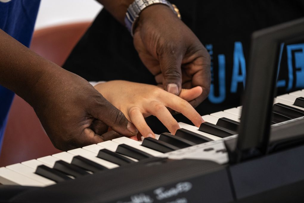 Kids get an introduction to keyboards at JazzED. (Dean Rutz / The Seattle Times)