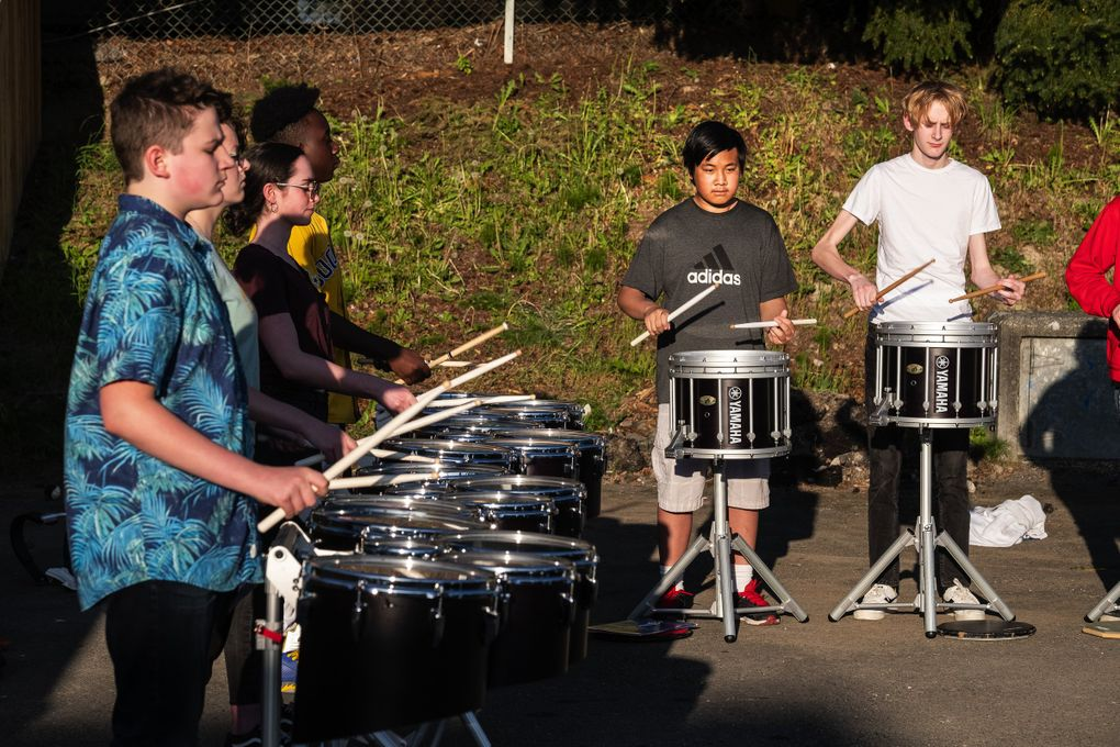 Tony Sodano's drum line, part of JazzED, rehearses in the parking lot of the former Martin Luther King Elementary School. From left: Conner Carr, Julianne Carroll, Isabel Russak, Jaelin Heyman, Paul Nguyen and Olaf Morrison. (Dean Rutz / The Seattle Times)