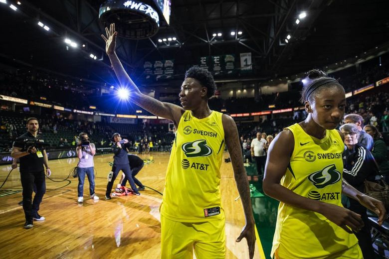 Natasha Howard and Jewell Loyd leave the floor following the Storm's 77-68 win over Phoenix in the WNBA opener Saturday, May 25, 2019 at Angel of the Winds Arena in Everett. (Dean Rutz / The Seattle Times)