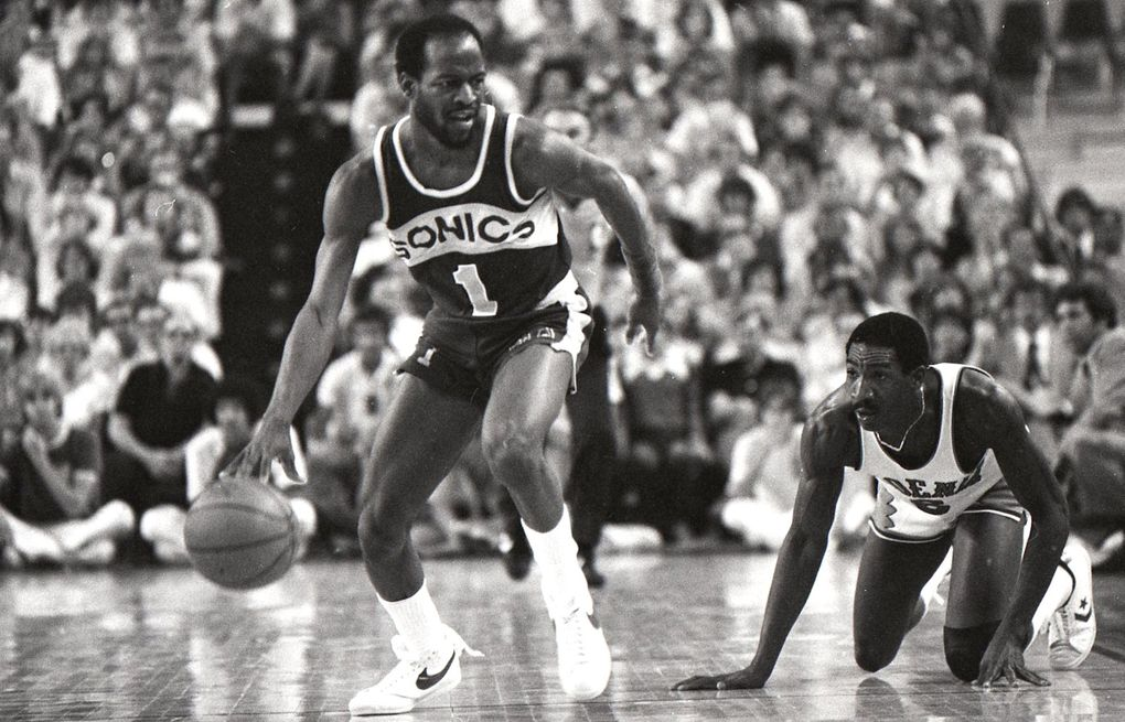 Sonics guard Gus Williams gets the ball away from Phoenix's Walter Davis during Game 6 of the Western Conference finals on May 13, 1979. The Sonics won 106-105.  (Matt McVay / The Seattle Times)