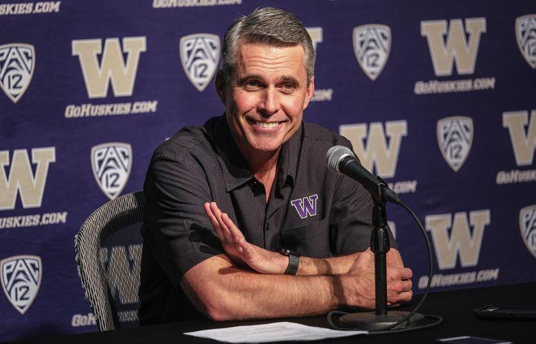 Washington coach Chris Petersen's 'OKG' philosophy is paying off in big academic progress scores. (Dean Rutz / The Seattle Times)