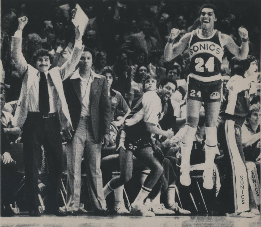 Sonics players and coaches celebrate their NBA championship victory over the Washington Bullets. If not for their dramatic Mother's Day win in Game 6 of the Western Conference Finals, they never would have made it to the Finals. (Associated Press)
