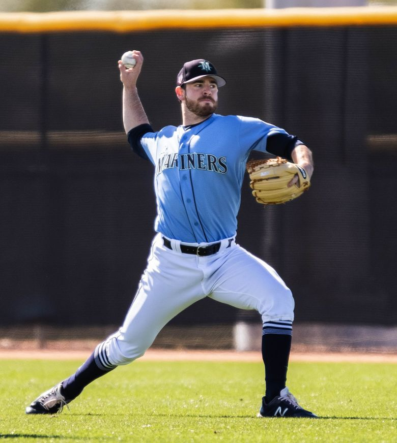 Pitcher Matt Festa warms up at Mariners spring training in February in Peoria, Arizona. (Dean Rutz / The Seattle Times)