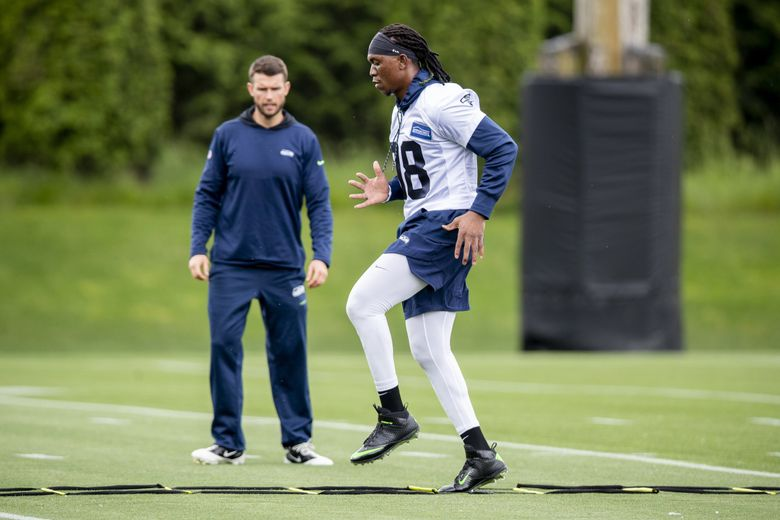 Seahawks defensive end Ziggy Ansah does ladder drills at the Seahawks' first open organized team activity practice May 21 in Renton. (Bettina Hansen / The Seattle Times)