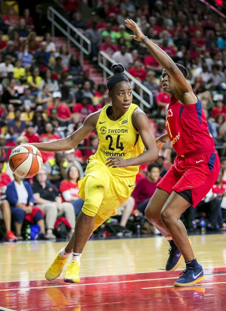 Storm guard Jewell Loyd (24) drives around Mystics guard Ariel Atkins in the WNBA Finals in 2018. (Bettina Hansen / The Seattle Times)