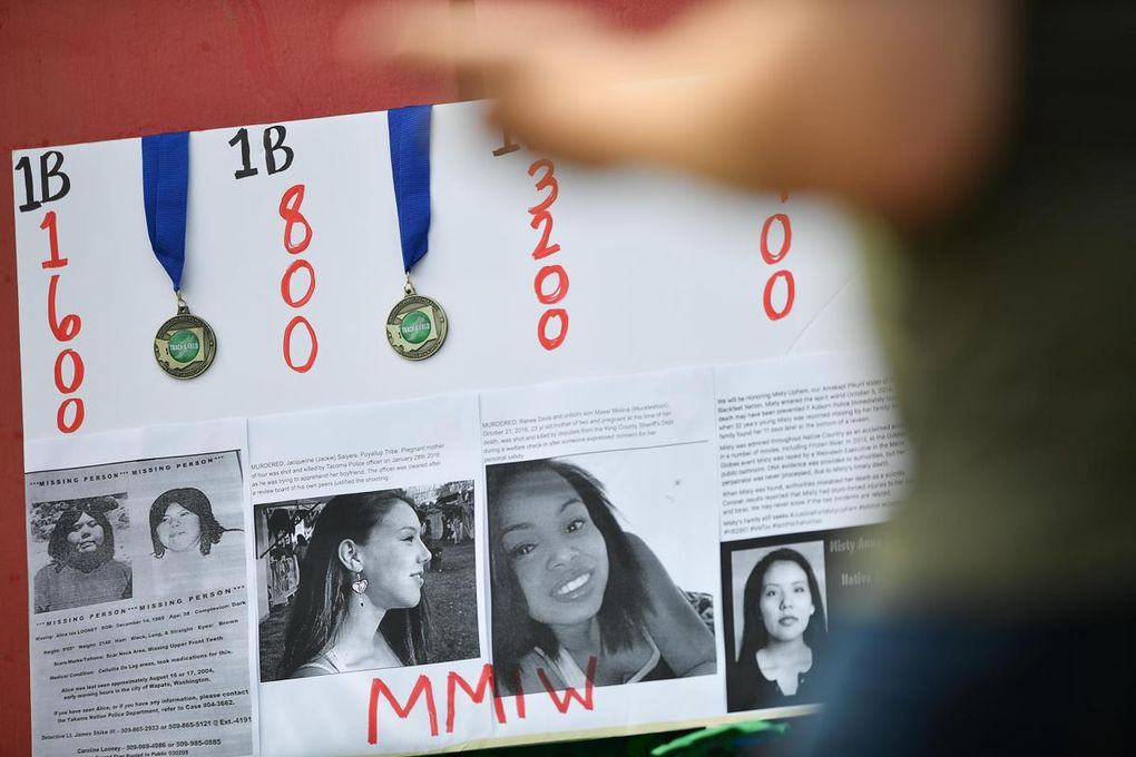 Rosalie Fish draped her running medals on a poster she made honoring Missing and Murdered Indigenous Women during the state track and field meet on May 25 in Cheney. (Tyler Tjomsland / The Spokesman-Review)