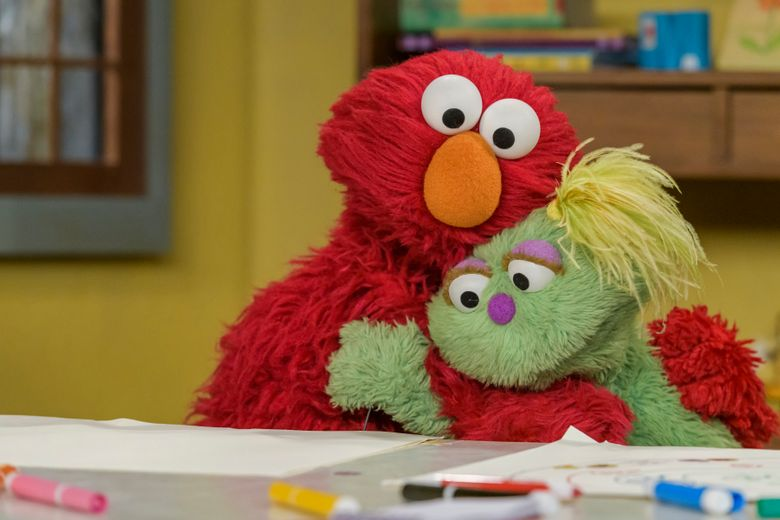 "Elmo hugs Karli, his new friend, on ""Sesame Street."" (Zach Hyman, Sesame Workshop)."