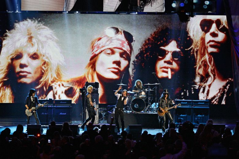 FILE – In this April 15, 2012, file photo, Guns N' Roses performs with singer Myles Kennedy after their induction into the Rock and Roll Hall of Fame in Cleveland. The rock band  is accusing a Colorado brewery of stealing their brand and piggybacking off their fame to sell beer and merchandise. The band filed a trademark infringement lawsuit Thursday, May 9, 2019, against Colorado-based Oskar Blues Brewery, which sells Guns 'N' Rosé beer and merchandise, including bandannas the group says is uniquely associated with singer Axl Rose. (AP Photo/Tony Dejak, File)
