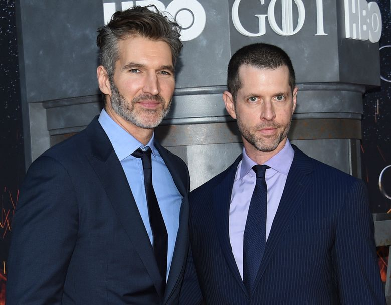 """FILE – In this Wednesday, April 3, 2019, file photo, creator/executive producers David Benioff, left, and D. B. Weiss attend HBO's """"Game of Thrones"""" final season premiere at Radio City Music Hall in New York. Walt Disney Co. CEO Bob Iger said Tuesday, May 14, 2019, that """"Game of Thrones"""" showrunners Benioff and Weiss are working on the new """"Star Wars"""" film expected in theaters in December 2022. (Photo by Evan Agostini/Invision/AP, File)"""