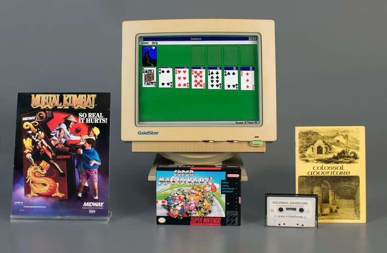 """In this April 10, 2019 photo provided by the Strong Museum in Rochester, N.Y., the video games inducted into the museum's World Video Game Hall of Fame on Thursday, May 2 are shown. In the front row from left are """"Mortal Kombat,"""" """"Super Mario Kart,"""" and """"Colossal Cave Adventure."""" On the monitor at rear is """"Microsoft Windows Solitaire."""" They were chosen from among 12 finalists that also included """"Candy Crush Saga,"""" """"Centipede,"""" """"Dance Dance Revolution,"""" """"Half-Life,"""" """"Myst,"""" """"NBA 2K,"""" """"Sid Meier's Civilization"""" and """"Super Smash Bros. Melee."""" (The Strong Museum via AP)"""