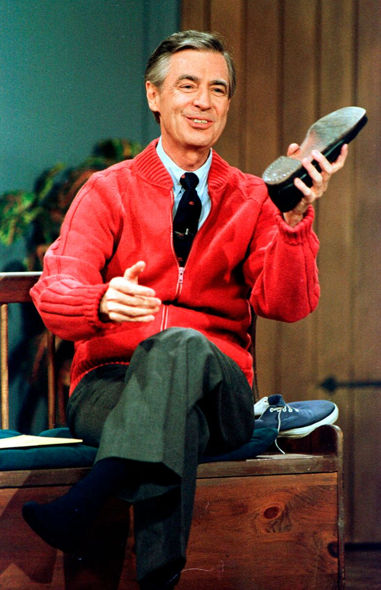 """FILE – This June 28, 1989 file photo shows Fred Rogers as he rehearses the opening of his PBS show """"Mister Rogers' Neighborhood"""" during a taping in Pittsburgh. Pennsylvania Gov. Tom Wolf said on Friday, May 10, 2019, that Pennsylvanians will be encouraged to exhibit acts of kindness later this month in honor of the beloved PBS children's show host. (AP Photo/Gene J. Puskar, File)"""