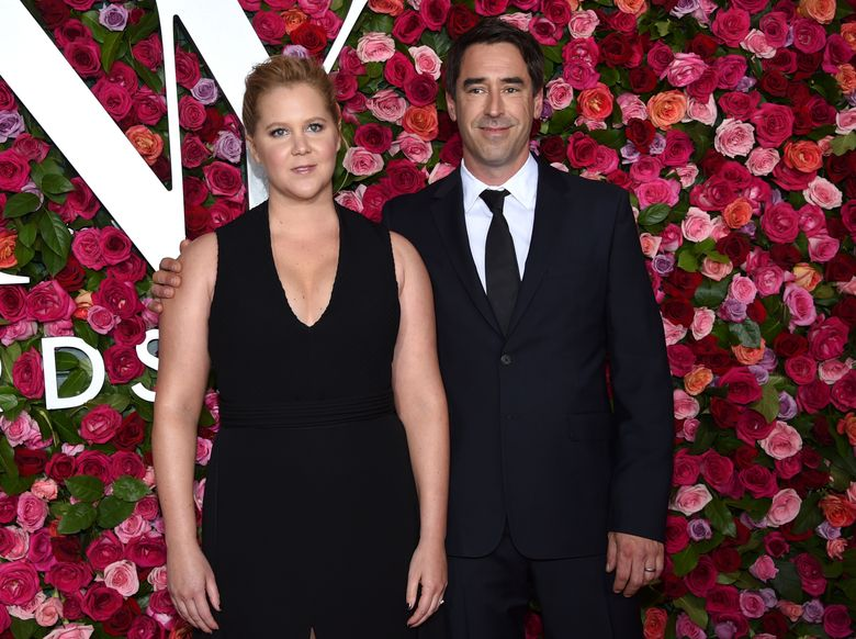 Amy Schumer, left, gave birth to a son with husband Chris Fischer Sunday, May 5, 2019. (Photo by Evan Agostini/Invision/AP, File)