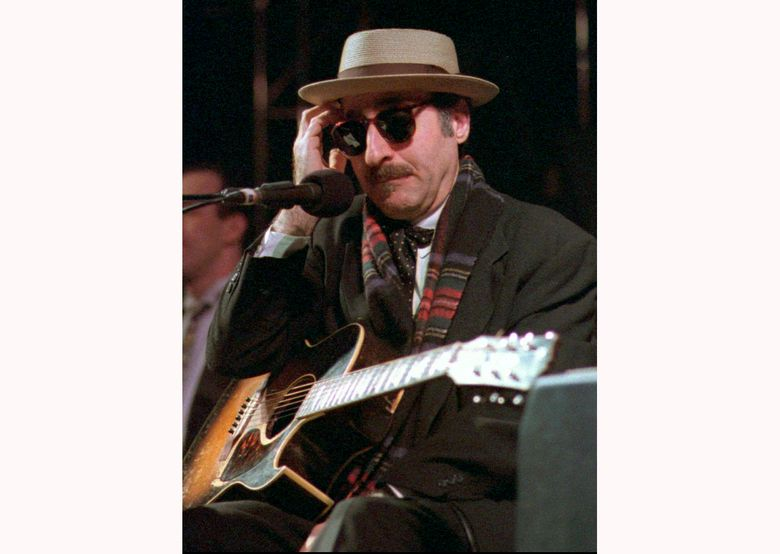 Leon Redbone performs March 28, 1998, at the eighth annual Redwood Coast Dixieland Jazz Festival in Eureka, Calif. Redbone, the acclaimed singer and guitarist who performed jazz, ragtime and Tin Pan Alley-styled songs, died Thursday, May 30, 2019, according to a statement released by his family. No details about his death were provided. (Patricia Wilson/The Times-Standard via AP, File)