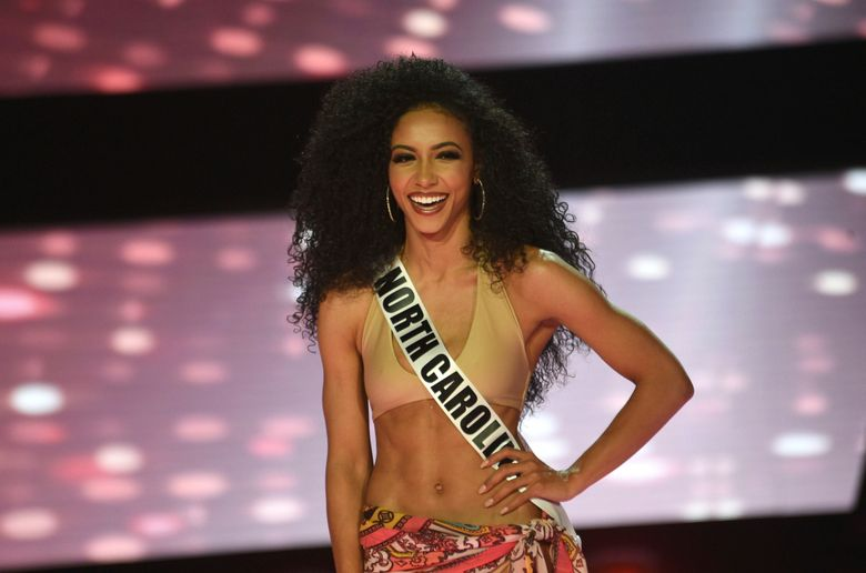 FILE – In this Thursday, May 2, 2019 file photo, Miss North Carolina Cheslie Kryst wins the 2019 Miss USA final competition in the Grand Theatre in the Grand Sierra Resort in Reno, Nev. Three black women are the reigning Miss USA, Miss Teen USA and Miss America. Chelsie Kryst completed the historic triple on Thursday, May 2, 2019 beside pageant winners 2019 Miss America Nia Franklin and recently crowned 2019 Miss Teen USA Kaliegh Garris. (Jason Bean/The Reno Gazette-Journal via AP, File)