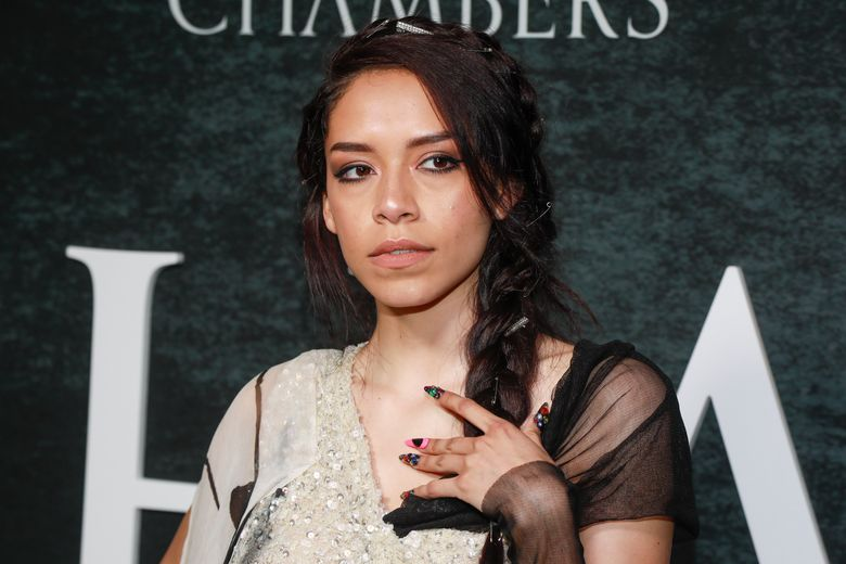 """FILE – This April 15, 2019 file photo shows Sivan Alyra Rose at the season premiere of Netflix's """"Chambers"""" in New York. Rose represents a rarity as one of the few people of Native American descent to star in a Netflix series. But she hopes her breakthrough will encourage more opportunities for women like her. (Photo by Andy Kropa/Invision/AP, File)"""