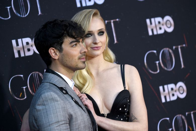 """Joe Jonas, left, and Sophie Turner attend HBO's """"Game of Thrones"""" final season premiere April 3 in New York. The couple have gotten married in a surprise ceremony in Las Vegas. (Photo by Evan Agostini/Invision/AP, file)"""