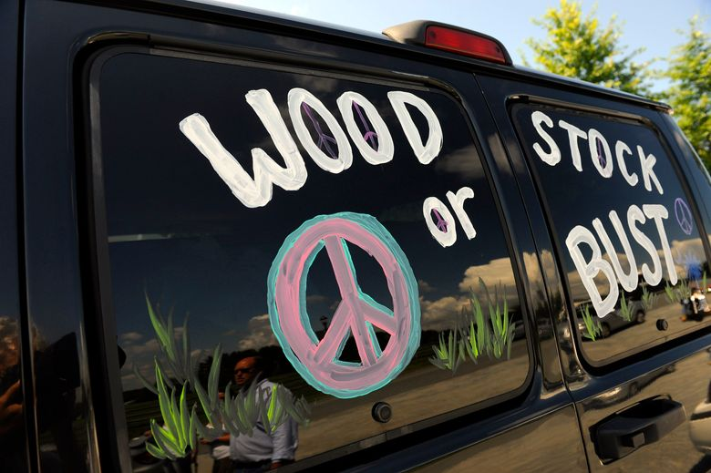 """FILE – This Aug. 14, 2009 file photo shows a van decorated with """"Woodstock or Bust"""" at the original Woodstock Festival site in Bethel, N.Y. The Woodstock 50 festival is back on after a court on Wednesday, May 15, 2019 rebuffed an ex-investor's effort to cancel the anniversary extravaganza. But organizers will have to do without some $18 million, at least for now. (AP Photo/Stephen Chernin, File)"""