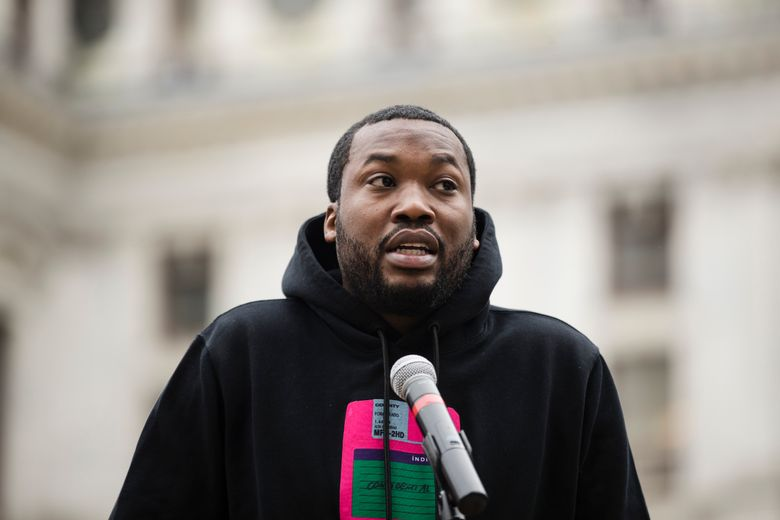 """FILE – In this April 2, 2019, file photo, rapper Meek Mill speaks at a gathering in Philadelphia to push for drastic changes to Pennsylvania's probation system. Philadelphia's District Attorney's office wants a new trial with a new judge for rapper Meek Mill. Larry Krasner submitted the brief Wednesday, May 22, 2019. He said former Judge Genece Brinkley's court """"abused its discretion"""" after sentencing Mill in 2017 to two to four years in prison for violating an old gun charge. (AP Photo/Matt Rourke, File)"""