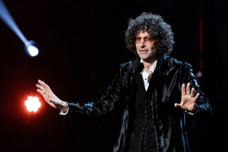 """FILE – In this April 14, 2018 file photo, Howard Stern speaks at the 2018 Rock and Roll Hall of Fame Induction Ceremony at Cleveland Public Auditorium in Cleveland. Stern talks about what he's learned, his regrets, and what he wishes he had gotten right in his new book """"Howard Stern Comes Again."""" It's a combination of interviews from Stern's radio show, interspersed with previously unspoken details about his life. (Photo by Michael Zorn/Invision/AP, File)"""